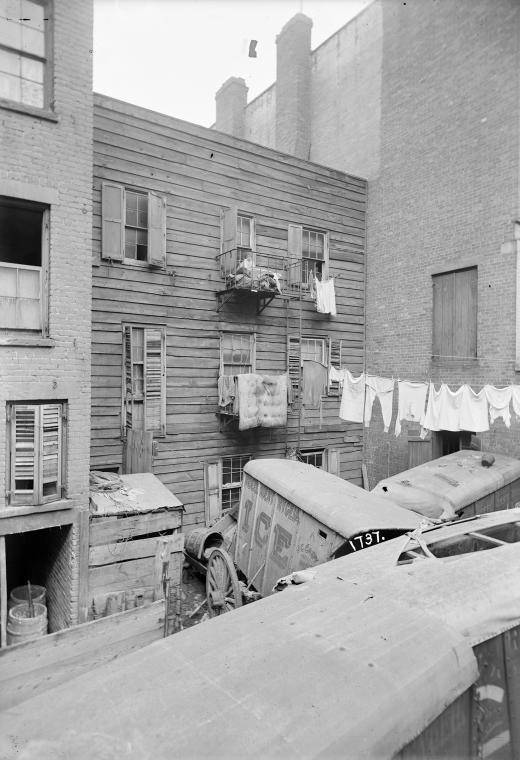 Ice Wagon in a tenement backyard – btw. 1902 and 1914