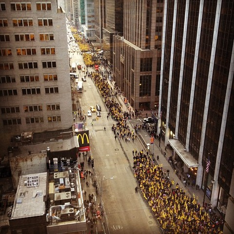 Workers gather at 47th Street and Sixth Ave
