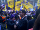 Ydanis Rodriguez stands in support with the SEIU