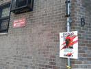 COP-SHOT poster and Seward Park Management Office sign