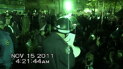 NYPD officer seen holding a megaphone