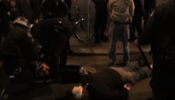 Protesters lying on the ground as NYPD officers stand over them