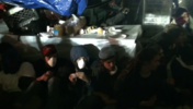 Protesters lined up along a table in Zuccotti