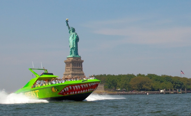 The Beast powerboat passes the Statue of Liberty