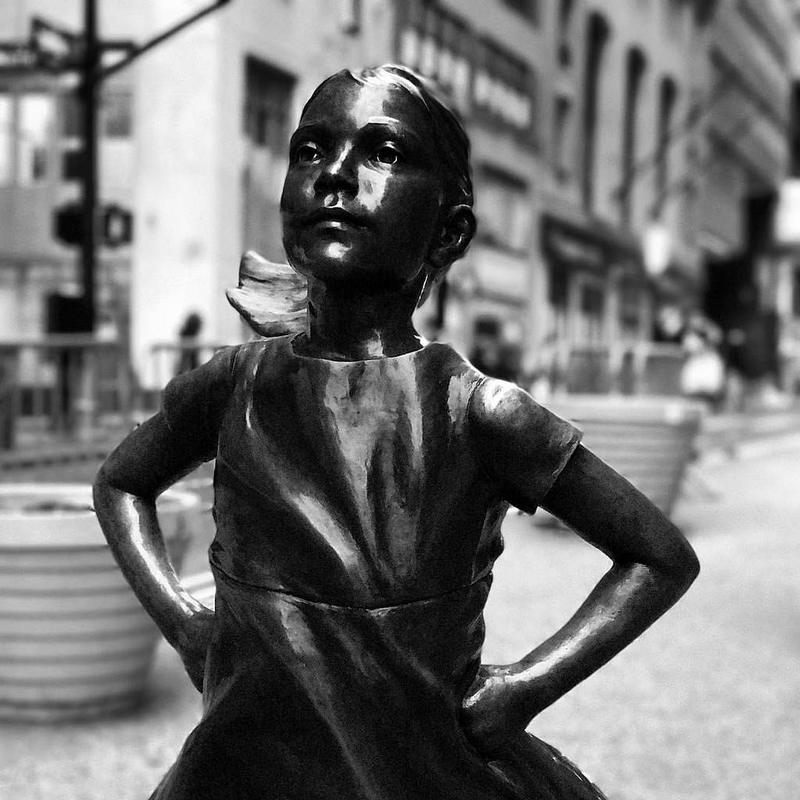 This fearless little girl rocks, she defies the charging bull! #nyc #fearlessgirl #chargingbull