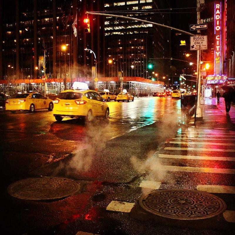 #NewYorkCity #NewYork, where the #streets look #steaming brilliant, even in the #rain! #NYC #BrightLights #Lights #Night #YellowCab #RadioCity